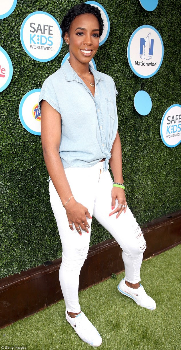 Glowing: The Destiny's Child star looked fabulous in a casual denim get-up which she teamed with white trainers
