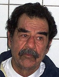 Republic of Iraq Former President Saddam Hussein, following his capture by US Army (USA) Soldiers in Tikrit, Iraq. Hussein had his beard shaven to confirm his identity.