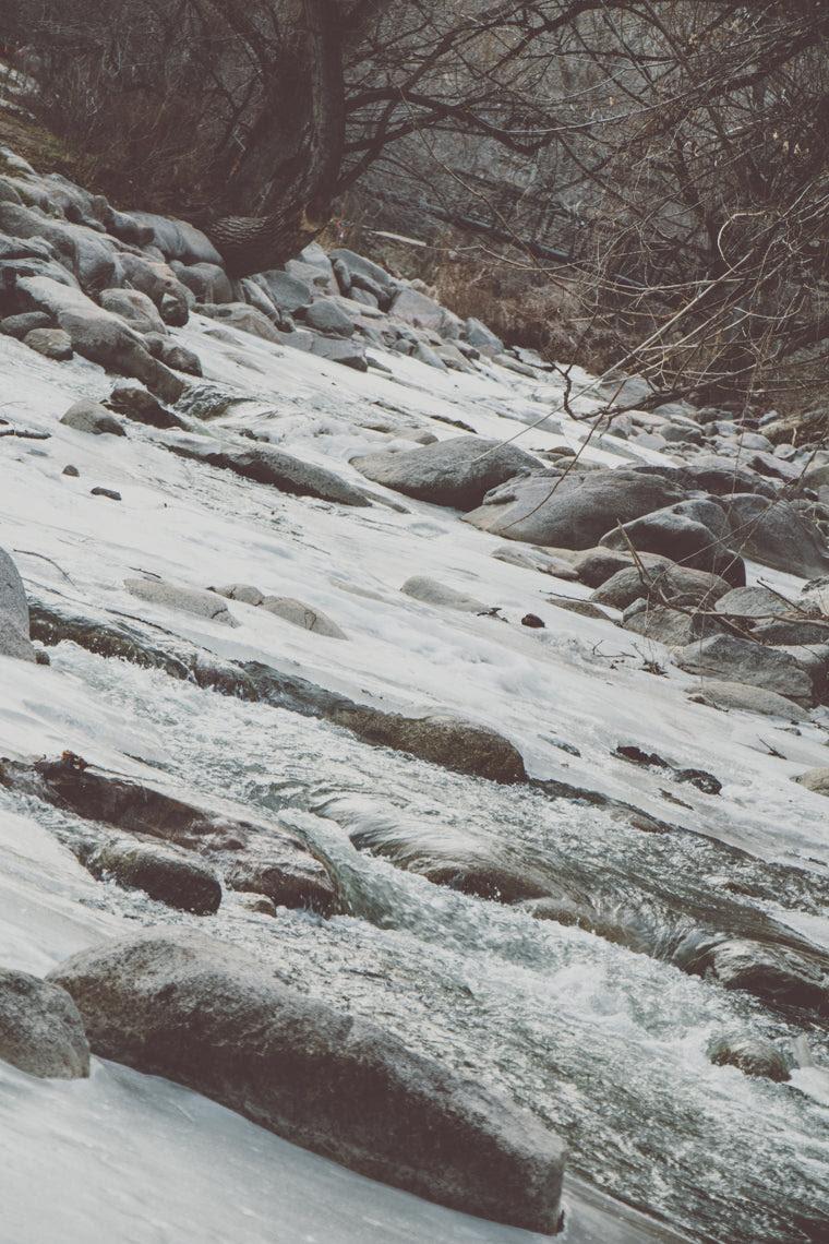 Photo of frozen river rapids in Boulder Colorado