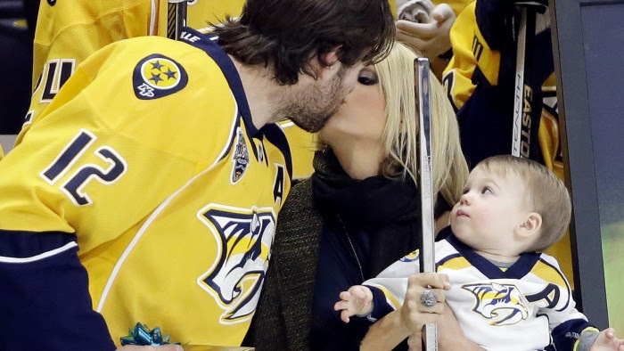 Image: Mike Fisher, Carrie Underwood, Isaiah Fisher