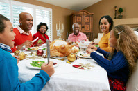 African American family sitting around holiday dinner table