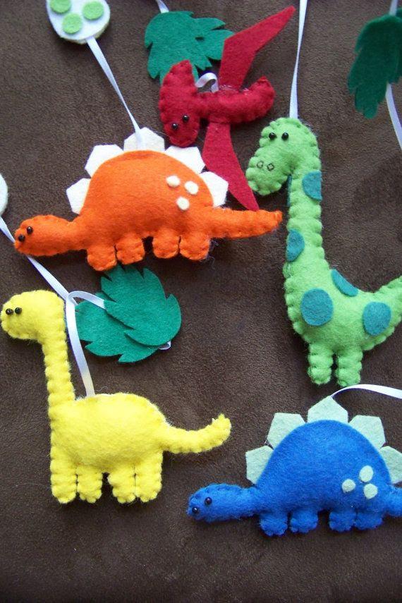 a herd of felt dinosaurs