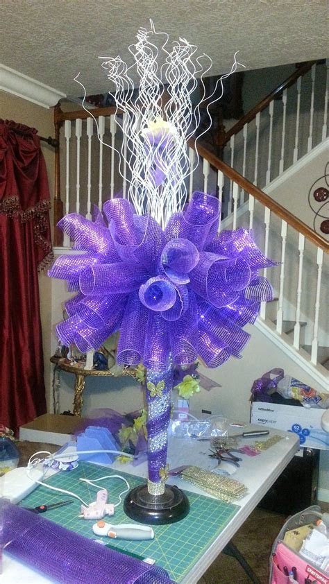 Niece's quinceanera large centerpiece using purple mesh