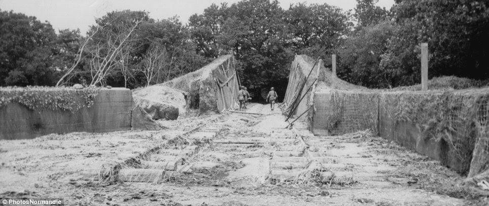 Engineering: Three GIs inspect a launch ramp north of Brix onJune 20, 1944 - two weeks after the D-day landing