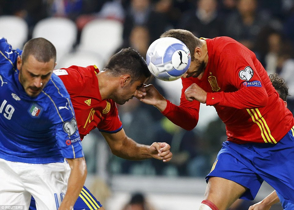 Gerard Pique (right) came close to opening the scoring in the first half but saw his header flash wide