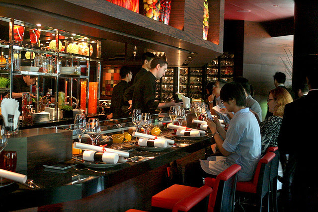 L'Atelier de Joël Robuchon seats 28 around its counter and 24 at tables