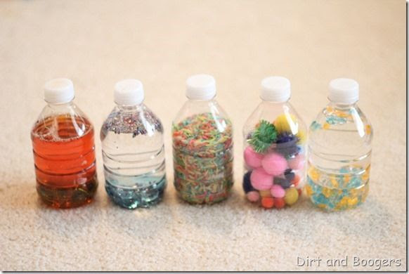 Baby Play: Discovery Bottles - Ozzie LOVED these. So easy to make. They are now filthy from him slobbering all over them.