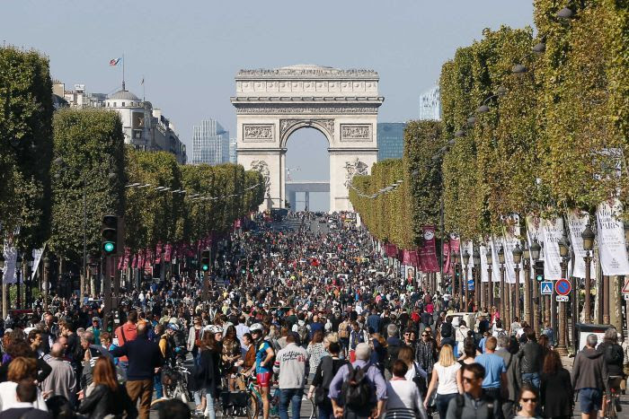 "People walk and cycle along the Champs Elysee Avenue during the ""Car-Free Day"" event taking place in the French capital Paris."
