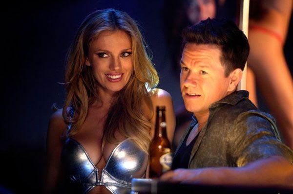 Sorina Luminita (Bar Paly) and Daniel Lugo hang out at a strip club in PAIN & GAIN.