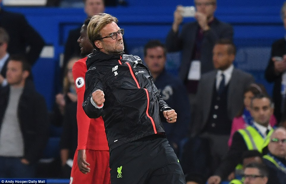 Jurgen Klopp celebrates in his usually enthusiastic manner after victory takes Liverpool into the top four