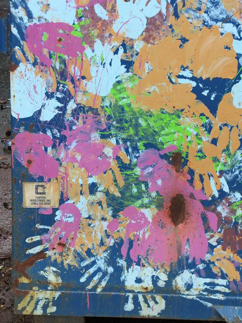 paint hand prints on a Juneau, Alaska dumpster