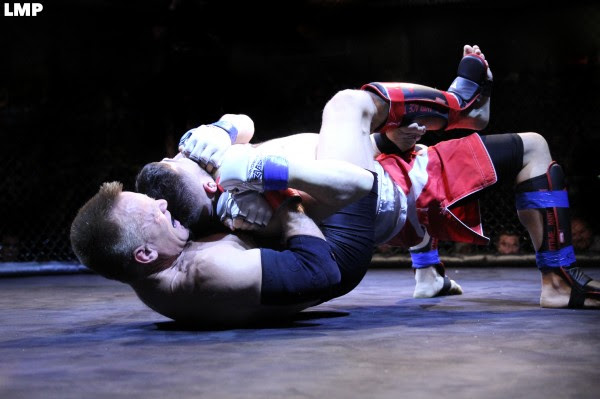 Patrick Kelly (bottom) battles Frank Dellasalla during New England Fights bout on Sept. 6 in Lewiston.