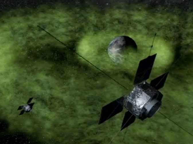 Graphic depiction of NASA's Van Allen Probes orbiting within Earth's radiation belts.