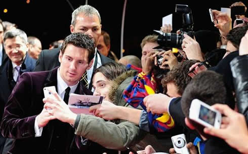 Lionel Messi taking a photo with fans at FIFA Balon d'Or 2011-2012 red carpet entrance