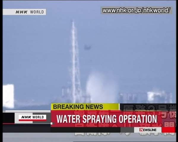 Helicopters dump water to cool reactor in Japan