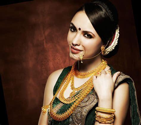 Modern stylish woman gold jewellery wear beautiful