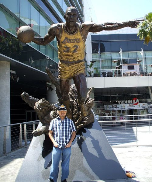 Posing in front of the Magic Johnson statue at STAPLES Center on June 19, 2010.  I'm wearing the Lakers' official 2010 championship baseball cap.
