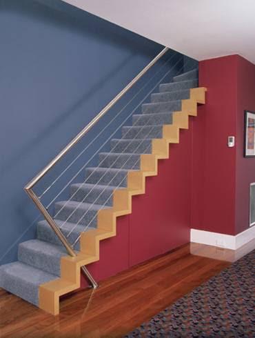 Escada que parece uma pintura tridimensional na parede.
