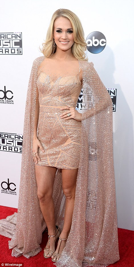 Natural beauty: Carrie Underwood shimmered in a nude dress with long caped sleeves