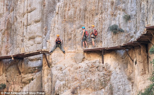 On the edge: A close-up shows sheer drop. Adrenaline junkies are flocking to take on the path after a youtube video appeared of a walker making the crossing wearing minimal safety equipment