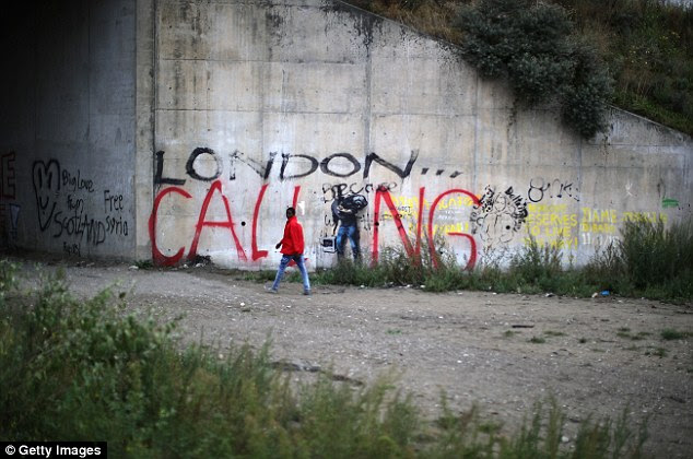 Dreams: 'London Calling' is sprayed across the length of a wall at The Jungle migrant camp