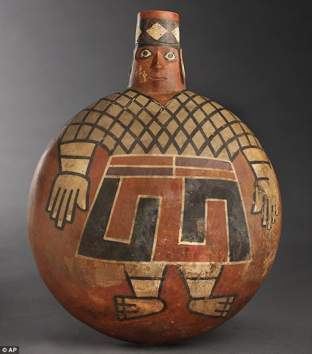 An unusually designed 1,200-year-old ceramic flask depicting a Wari lord with eyes wide open, was among a wealth of ceramic artifacts discovered in the tomb