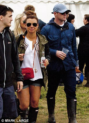 Mind elsewhere: Wayne Rooney was at Glastonbury on Friday as he contemplates his future