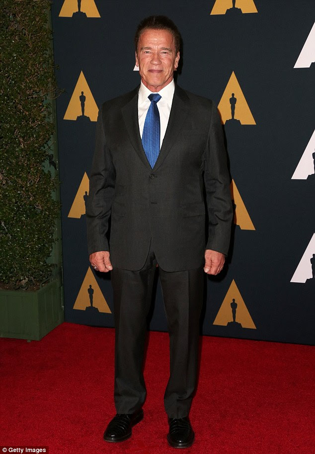 Dapper: The 69-year-old actor was at the event in a black suit with a white dress shirt and blue tie