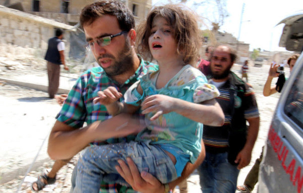 A man carries a girl that survived double airstrikes on the rebel held Bab al-Nairab neighborhood of Aleppo