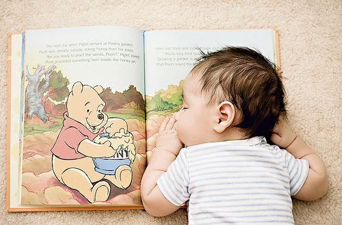 Cute kids - baby asleep reading Winnie the Pooh