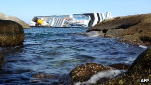The capsized Costa Concordia lies off the coast of the island of Giglio