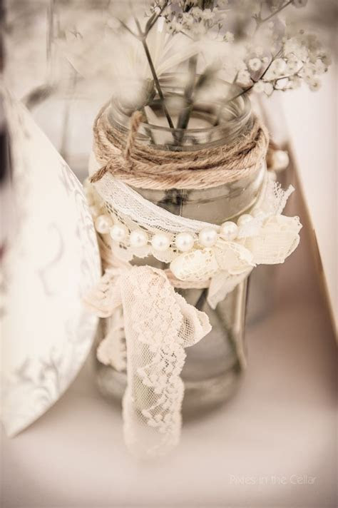 Jam jar table decorations, vintage lace and pearls