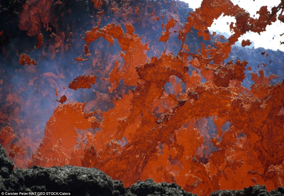 Danger: Fiery lava is flunged tens of feet up in the air splashes down Mount Etna on the island of Sicily, Italy