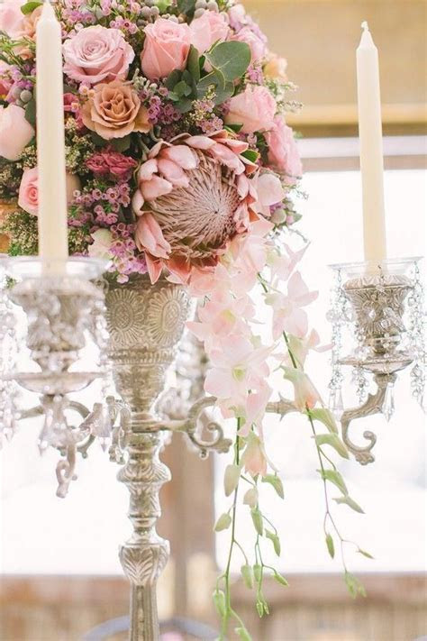Cascading wedding centerpiece with protea roses and