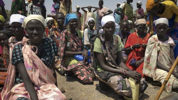 Women wait to receive food in South Sudan