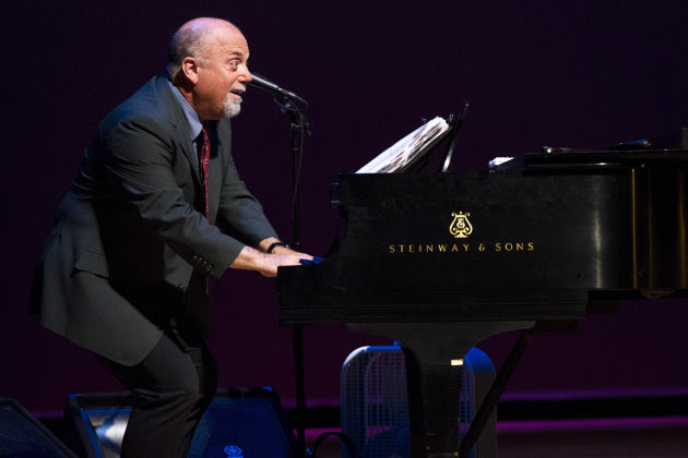 Billy Joel appears on stage at a special master class school-wide assembly event for the Frank Sinatra School of the Arts, the public high school Tony Bennett founded, on Thursday, May 30, 2013 in New York. (Photo by Charles Sykes/Invision/AP)