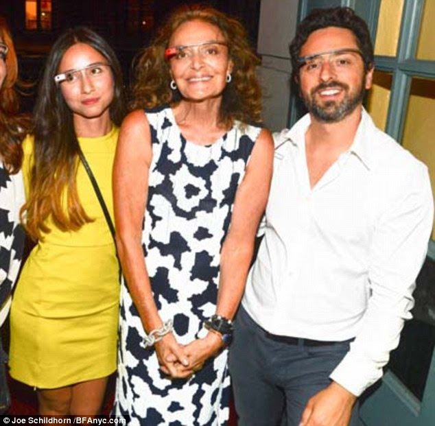 Amanda Rosenberg (left), with Diane von Furstenberg and Sergey Brin at New York fashion week. The British lover of Google co-founder Sergey Brin started her affair with him after befriending his wife, it emerged yesterday