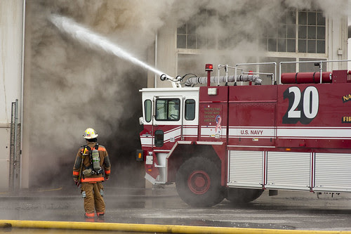 Firefighters put out fire aboard Naval Station Norfolk. by Official U.S. Navy Imagery
