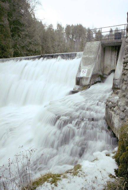 Flowing over the dam.