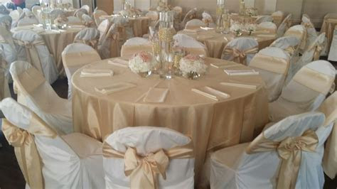 Soft Gold Shantung tablecloths and chair sashes, ivory