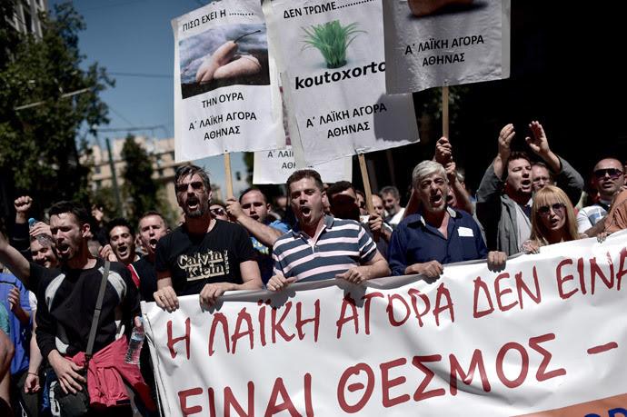 Farmers' market producers and vendors of the common open air markets prevalent across Greece shout slogans as they protest against liberal reforms in central Athens on May 2, 2014. (AFP Photo / Aris Messinis)