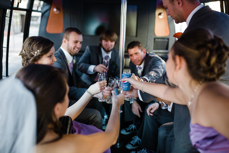 Photos with the bride, groom, and wedding party on the party bus after a wedding at second first congregational heading to the hoffman house in scenic downtown Rockford while be had some beautiful autmn weather.