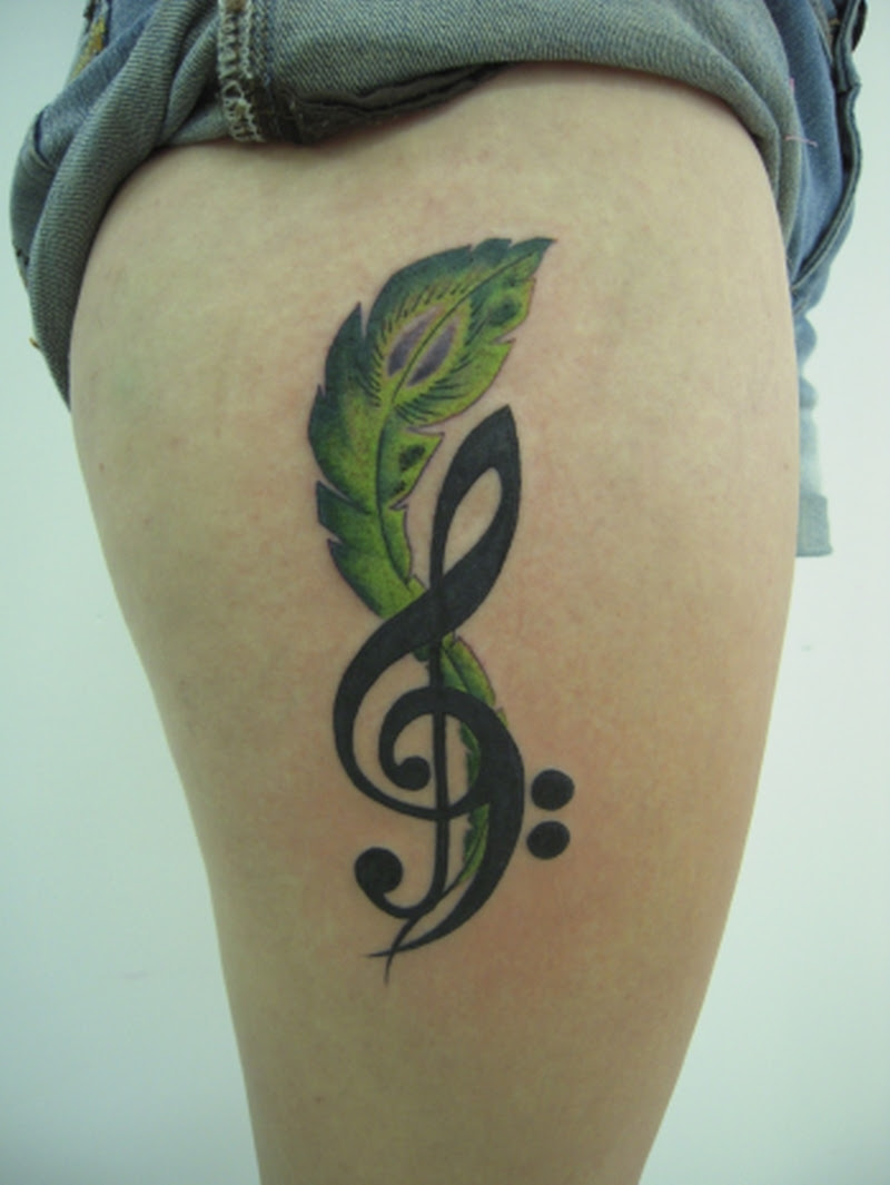 Green Feather N Music Note Tattoo On Right Thigh Tattoos Book