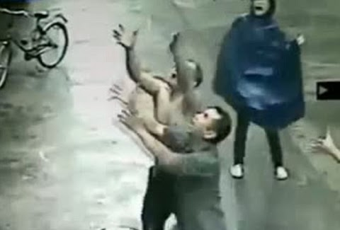 Heart-stopping moment passerby CATCHES A BABY after it slipped from second-storey window ledge in pouring rain while looking for its mother in China