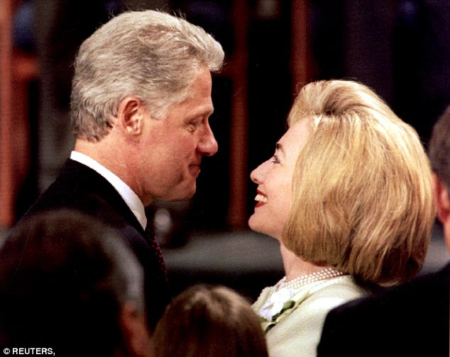 The first whiff of scandal to surround the Clintons began with the 1993 sacking of the seven employees in the White House Travel Office (Clintons pictured in 1998)
