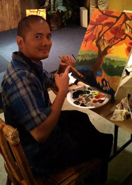 Painting a spooky tree at a restaurant in Huntington Beach...on October 23, 2015.