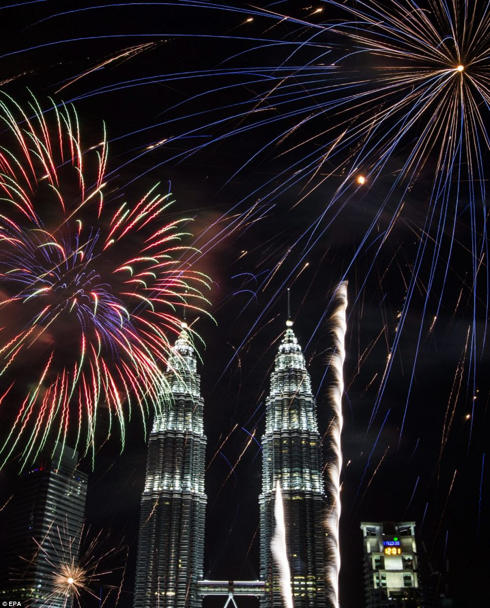 Soaring into the air: The fireworks near Malaysia's iconic Petronas Towers heralded a new start and a new year for many