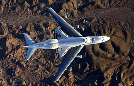 The space shuttle Endeavour, mounted on top of a modified Boeing 747 carrier aircraft, flies over California's Mojave Desert