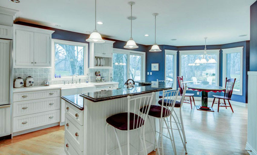 Kitchen white cabinets blue walls | Hawk Haven