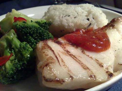 Grilled cod fish with clam tomato sauce